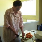 Andrea making lacto-fermented carrots.